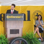 In this AP file photo, Continental Tire of the Americas CEO Jochen Etzel, left, thanks South Carolina Gov. Nikki Haley, right, for her help in getting the German tire maker to build a new plant at a groundbreaking ceremony in Sumter, S.C., on March 28, 2012. The company is planning a $1.45 billion investment in a Mississippi plant that is expected to create 2,500 jobs.