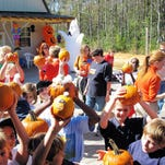 Kids on deck with pumpkins at the Pumpkin Patch Express in Silverhill, Alabama.