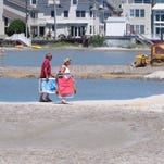 Dunes creating stagnant ponds that separate homes from beach