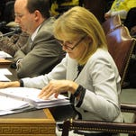 Health and Hospitals Secretary Kathy Kliebert reviews notes and financial documents before making her budget presentation to the House Appropriations Committee Wednesday in Baton Rouge. Lawmakers on the committee expressed concerns about possible cuts to health services for next year.