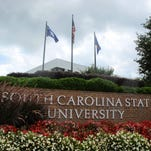 In this July 22, 2014, file photo, flags fly at the entrance to South Carolina State University in Orangeburg.