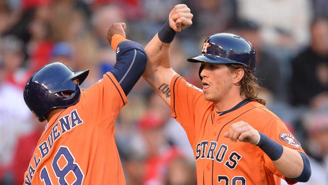 Astros left fielder Colby Rasmus is greeted by third baseman Luis Valbuena after a two-run home run.