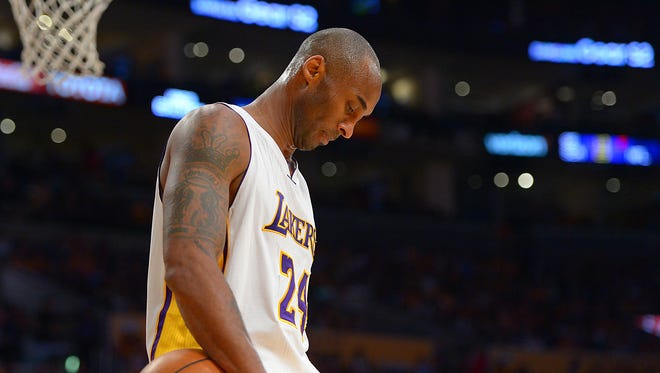Los Angeles Lakers forward Kobe Bryant (24) reacts in the second half of the game against the Portland Trail Blazers at Staples Center.