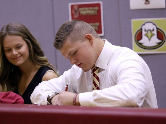 First Baptist Academy linebacker Joe Sparacio signs his National Letter of Intent to join Boston College in a few weeks during the Early Signing Period on Wednesday, Dec. 20, 2017.
