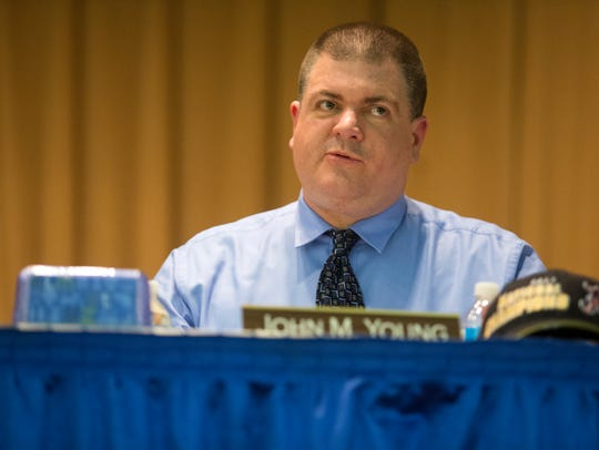 Christina School District board member John Young voted against eliminating teaching positions. The board voted 4-3 to lay off five teachers.