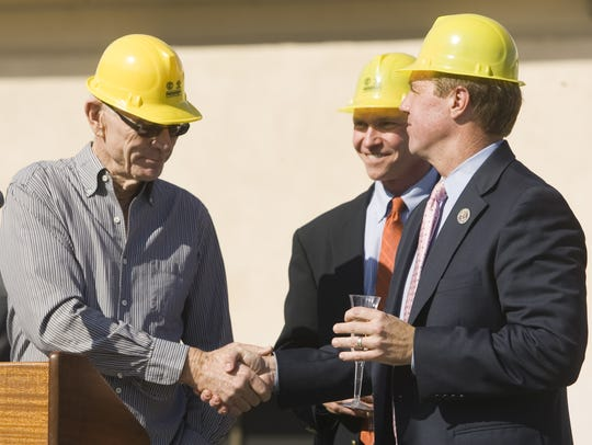 John Wessman, left, shakes the hand of Palm Springs