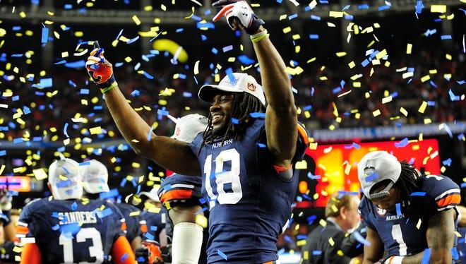 Auburn wide receiver Sammie Coates  celebrates after the 2013 SEC Championship game against Missouri.