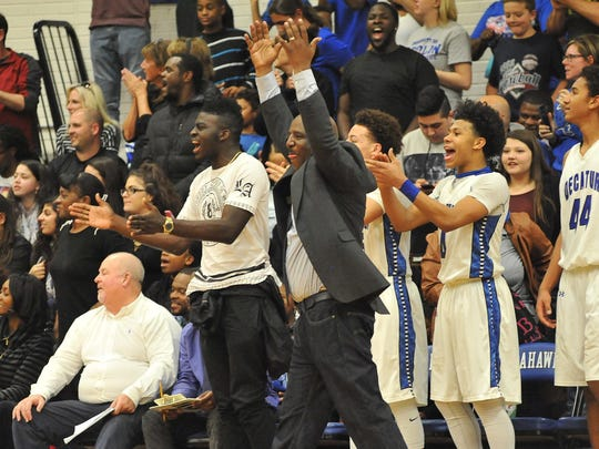 Stephen Decatur's Head Coach Bryon John celebrates as the buzzer sounds with the win against Centennial High School during Saturday's 3A East Regional Championships in Berlin, Md. Megan Raymond Photo