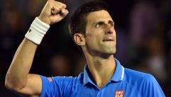 Novak Djokovic of Serbia celebrates winning the first