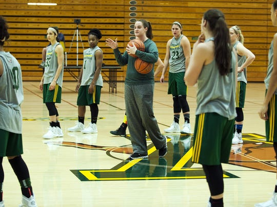 UVM assistant coach Courtnay Pilypaitis talks to the team during practice at Patrick Gym last week.