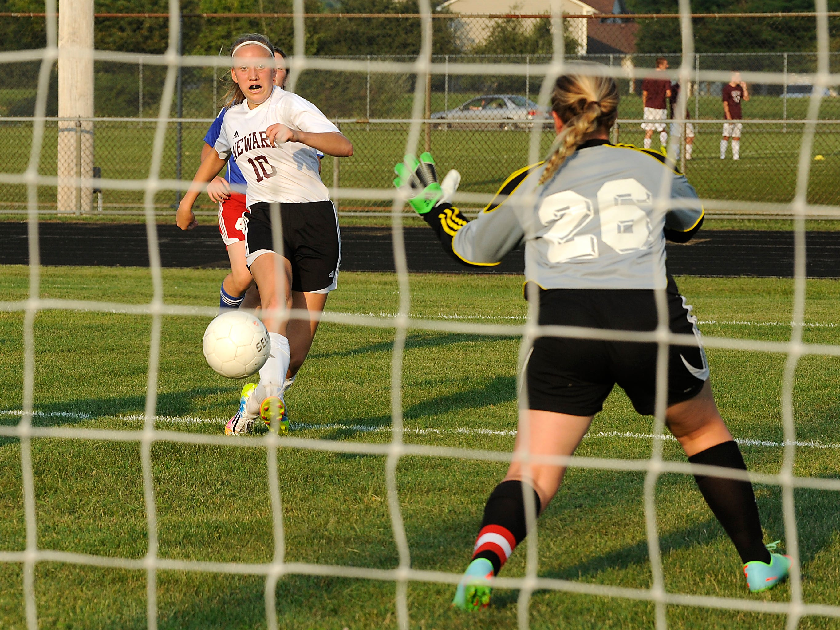 Newark's Alei Yost scores a goal against Licking Valley goalkeeper Kelsea Hagan during the Wildcats 9-0 victory against the Panthers on Tuesday at Evans Athletic Complex.