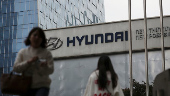FILE - In this Oct. 26, 2017, file photo, the logo of Hyundai Motor Co. is displayed at the automaker's showroom in Seoul, South Korea. Hyundai Motor Co. says it will release its first self-driving vehicles to markets by 2021 in partnership with U.S. self-driving technology startup Aurora Innovation Inc. (AP Photo/Lee Jin-man, File)