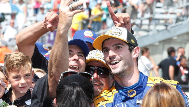 Verizon Indy Car owner Bryan Herta takes a selfie with driver Alexander Rossi after winning the 100th running of the Indianapolis 500.