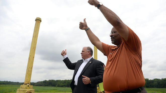 Bridgeton mayor Albert Kelly (right) and NJ State Senate President Steve Sweeney, give thumbs-up to spectators after they close the last gate to allow Sunset Lake to refill.