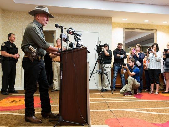 Clay Higgins speaks during a press conference announcing