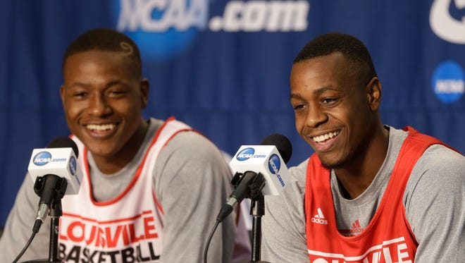 Louisville guards Terry Rozier, left, and Chris Jones, smile during a news conference at at the NCAA mens college basketball tournament Friday, March 21, 2014, in Orlando, Fla. Louisville will play Saint Louis in the third-round game on Saturday.(AP Photo/John Raoux)
