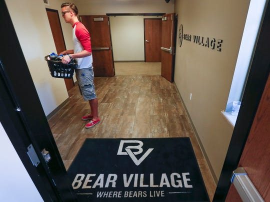 Dylan Earnshaw, of Cheyenne, Wyoming, waits for the elevator as while moving into his new apartment at Bear Village on Tuesday, August 16, 2016. Earnshaw will be getting his graduate degree in Industrial Organizational Psychology from MSU.