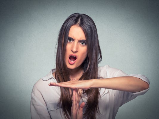 Woman showing time out hand gesture screaming