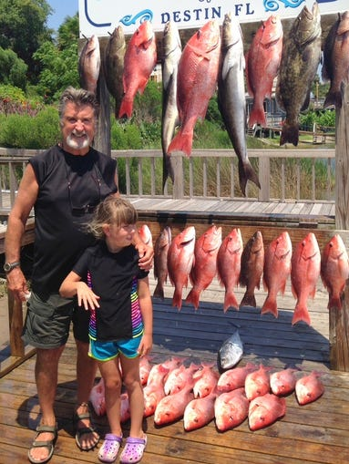 Brentwood's Johnny Lovier and his daughter Dorothy Grace, 5, caught these grouper and red and black snapper in Destin, Fla.