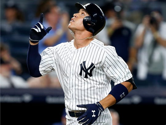 New York Yankees' Aaron Judge points skyward after