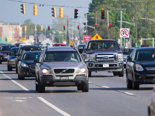 Traffic drives on U.S. 13 in Dover. The city is hosting two commencement ceremonies and the annual Dover Days Festival this weekend.