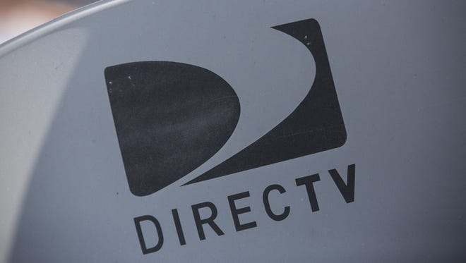 A DirecTV sattelite dish sits on a roof on May 19, 2014 in New York City.