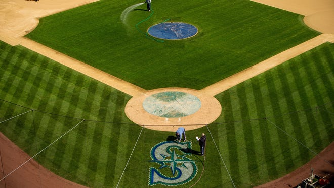 In this Thursday, April 2, 2015, photo, Safeco Field is prepped, painted and watered for the Mariners 2015 season in Seattle, Washington. Opening Day is Monday, April 6.