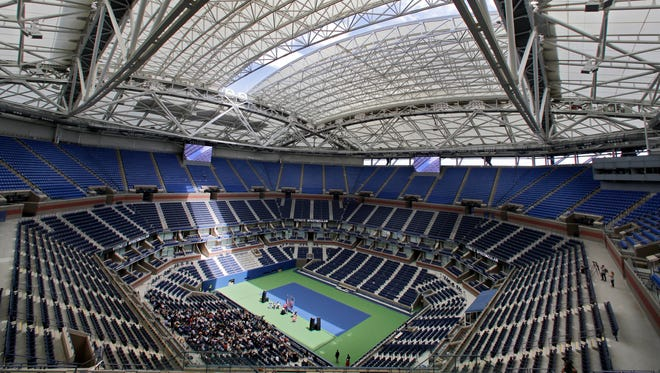 With Arthur Ashe Stadium now covered by a retractable roof, players such as defending champ Novak Djokovic wonder how it will affect conditions when it is closed.