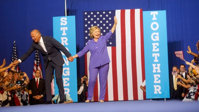 Hillary Clinton and Vice President Biden greet the crowd on Aug. 15, 2016, in Scranton, Pa.