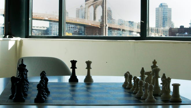 The Brooklyn bridge is seen at the background while a chess table is setup next to the room where Magnus Carlsen, Norwegian chess grandmaster, and current World Chess Champion and Sergey Karjakin, Russian chess grandmaster attend a press conference on November 10, 2016, in New York City.
