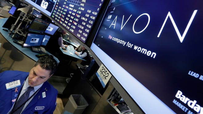 FILE - In this Tuesday, March 15, 2016, file photo, specialist Ronnie Howard works under the Avon logo on the floor of the New York Stock Exchange. Avon's CEO, Sheri McCoy, will be stepping down in March 2018, as the struggling beauty company continues to work on turning around its business. (AP Photo/Richard Drew, File) ORG XMIT: NYAG402