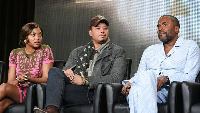 """From left, actors Taraji P. Henson, Terrence Howard, and director Lee Daniels speak on stage during the """"Empire"""" panel at the Fox 2015 Winter TCA, in Pasadena, Calif."""