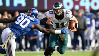 Giants defensive star Jason Pierre-Paul (90) just before sacking Philadelphia Eagles quarterback Carson Wentz (11) last November in a game at MetLife Stadium.