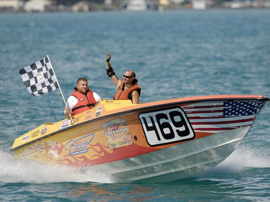 The Crockett Rocket team waves to the crowd after winning its race during the St. Clair River Classic.