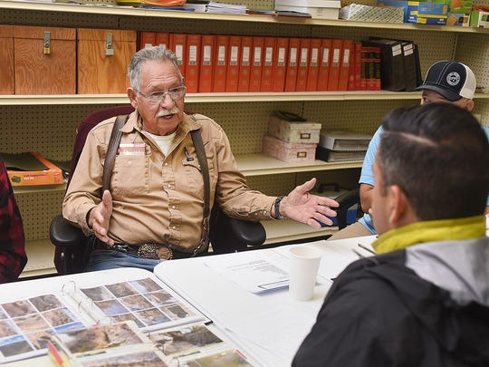 Leonard Trujillo, a member of the Bloomfield Irrigation District board, talks on Tuesday with U.S. Rep. Ben Ray Luján at the district office in Bloomfield.