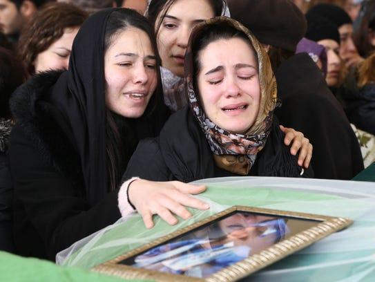 Relatives of Zeynep Basak Gulsoy, who was killed in