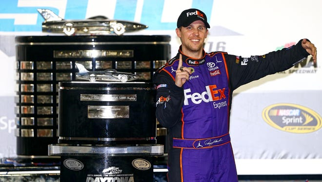 Denny Hamlin poses with the Harley J. Earl Trophy after winning the 2016 Daytona 500.
