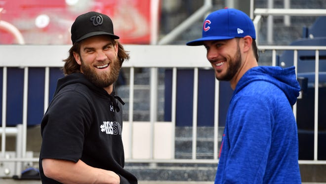 Nationals' Bryce Harper talks with Cubs' Kris Bryant the day before Game 1 of the NLDS.