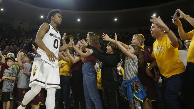 ASU's Tra Holder (0) high-fives fans after beating Colorado at Wells Fargo Arena on January 27, 2018 in Tempe, Ariz.