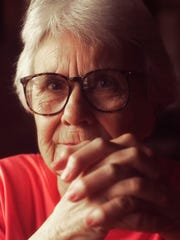 "Author Harper Lee, who wrote ""To Kill a Mockingbird,"" is pictured at the Stage Coach Cafe in Stockton, Ala., in August 2001. The surprise sequel, ""Go Set a Watchman,"" will be published July 13. (Terrence Antonio James/Chicago Tribune/TNS)"