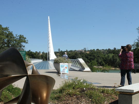 The Sundial Bridge at Turtle Bay Exploration Park on the summer solstice draws steady pedestrian traffic.