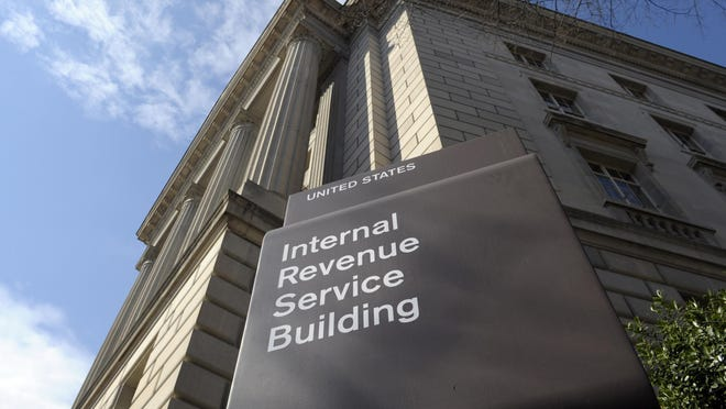 """FILE - In this photo March 22, 2013 file photo, the exterior of the Internal Revenue Service (IRS) building in Washington. Most Americans say President Donald Trump's tax plan would benefit the wealthy and corporations, and less than half believe the president's message that """"massive tax cuts"""" would benefit middle-class workers, according to a new Associated Press-NORC poll. The survey, conducted by The Associated Press-NORC Center for Public Affairs Research, could serve as a warning sign for a president who is prodding congressional Republicans to support his proposal as he searches for a major legislative achievement ahead of the 2018 midterm elections. (AP Photo/Susan Walsh, File)"""