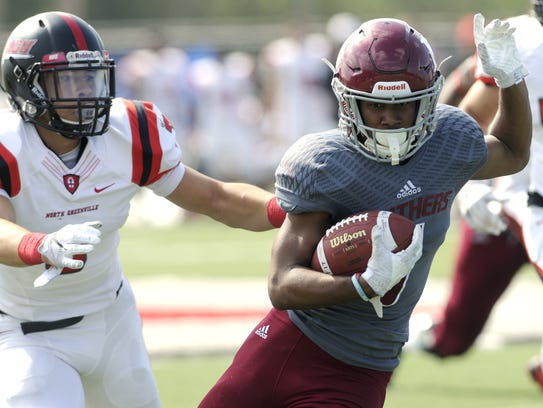 Antwuan Haynes runs for a first down during Saturday's
