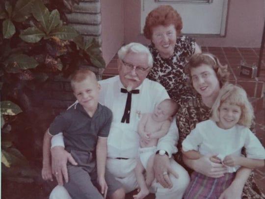 Colonel Harland Sanders poses with daughter Margaret Sanders, great-grandson John Joseph Wurster, baby Harland James Wurster, granddaughter Josephine Wurster and Cindy Wurster. Courtesy of Cindy Wurster Sjogren