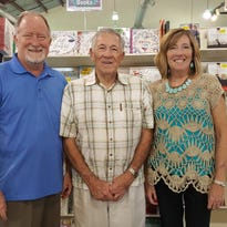 Curtis McGinnis, center, founder of Cedar Springs Christian Store, with son Link McGinnis and daughter Vicki Geist.