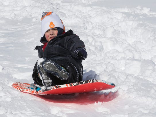 Logan Deans, 5, sleds at the Dunfee School in Barnegat. If New Jersey changed state law so that public schools could hold virtual instruction on snow days, free days spent like this might become a thing of the past.