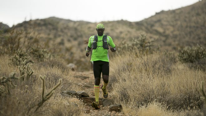 Otis Ward of Surprise trail runs on the Willow Canyon Trail in the White Tank Mountain Regional Park outside Waddell on November 17, 2017.