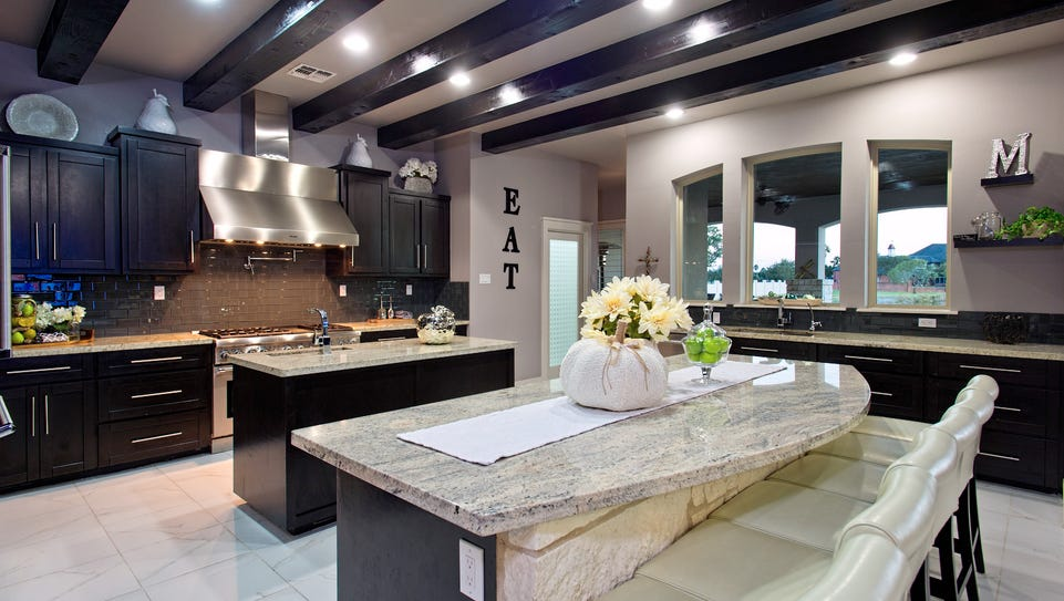 The wonderful and spacious  kitchen has a beamed ceiling,