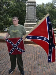 Allen Armentrout stands in front of the Confederate