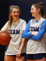 Mountain Lakes juniors Brenna Wilson, l, and Emily